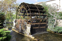 TheTourelles water wheel was constructed by royal decree in 1832 and still turns today.  One of 14 in the busy market town of  L'Isle-sur-la-Sorge in the Luberon district of Provence, France, it once powered the town's factories for corn and cloth.
