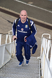 CARDIFF, WALES - Thursday, March 26, 2015: Wales' sport psychologist Ian Mitchall boards the flight at Cardiff Airport as the squad prepare to fly to Tel Aviv ahead of the UEFA Euro 2016 qualifying Group B match against Israel. (Pic by David Rawcliffe/Propaganda)