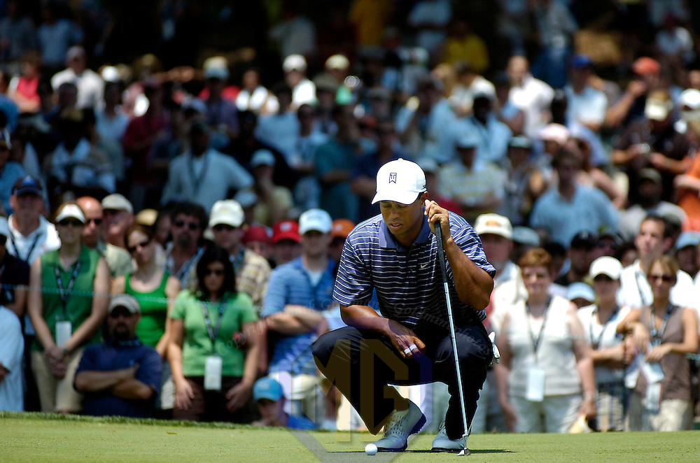 07 July 2007:  Tiger Woods looks to line up a putt on the 8th hole with a large gallery behind him in the third round of the inaugural AT&T National PGA event at Congressional Country Club in Bethesda, Md.  ****For Editorial Use Only****