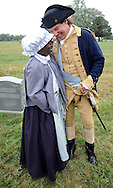 "SHANNAH08P<br /> Euell Aira Nielsen (left) of Lansdowne, Pennsylvania, portraying Hannah Till, shares a laugh with Samuel Davis (right) of Chesterfield, New Jersey portraying George Washington during a dedication ceremony honoring Hannah Till Saturday October 3, 2015 at Eden Cemetery in Collingdale, Pennsylvania. Hannah Till, a free black woman and unsung hero of the Revolutionary War who worked for Gens. George Washington and Lafayette is being honored as a ""Patriot"" by the Daughters of the American Revolution with a special ceremony and headstone dedication at Eden Cemetery, a historically-black cemetery in Collingdale. (William Thomas Cain/For The Inquirer)"