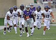 Wide receiver Isaiah Harris #2 of the Kansas State Wildcats returns the opening kick-off 96 yards against the Central Arkansas Bears during the first half at Bill Snyder Family Stadium in Manhattan, Kansas.