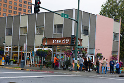 Exterior of the Snow City Cafe restaurant with crowd of people waiting outside for a table, downtown, Anchorage, Alaska, United States of America