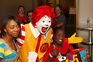 Ronald McDonald stops for photos with fans during the 10th Annual Celebrating life & health free community health fair at Sinclair's Ponitz Center in downtown Dayton, Saturday, April 21, 2012. More than 50 vendors were spread over three floors providing vision, hearing, blood pressure and other screenings, health information and entertainment.