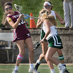 Villa Duchesne's Grace Walsh (13) passed in the second half of a game between Nerinx Hall High School and Villa Duchesne at Nerinx Hall in Webster Groves April 5, 2016. Villa Duchesne won 9-8. Teak Phillips | St. Louis Review