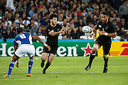 Victor Vito passes to  Nehe Milner-Skudderd during the New Zealand All Blacks v Namibia Rugby World Cup 2015 match. The Stadium Queen Elizabeth Park in London, UK. Thursday 24 Septebmer 2015. Copyright Photo: Libby Law / www.Photosport.nz