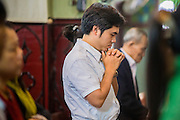 08 APRIL 2012 - HANOI, VIETNAM:   A man prays during Easter Sunday mass in St. Joseph Cathedral in Hanoi, Vietnam. St. Joseph Cathedral in Hanoi is the seat of the Roman Catholic Archdiocese of Hanoi and is one of the most important Catholic churches in Vietnam. It was built in 1886 and is especially crowded on religious holidays, like Easter. The church holds three Easter masses on Easter Sunday morning. There are more than 5.6 million Roman Catholics in Vietnam, nearly 7% of the population. Catholicism came to what is now Vietnam with Portuguese missionaries in the 16th Century, but it wasn't until the arrival of French missionaries and later colonial authorities that Catholicism became a part of Vietnamese religious life.      PHOTO BY JACK KURTZ