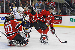 December 28, 2007; Newark, NJ, USA;  Buffalo Sabres left wing Thomas Vanek (26) interferes with New Jersey Devils goalie Martin Brodeur (30) during the first period at the Prudential Center in Newark, NJ.
