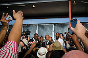 Matt Roth/Novus Select.Thursday, March 22, 2012..Members of the press photograph Rev. Al Sharpton, while he announces that the Sanford Chief of Police Bill Lee has temporarily stepped down before the official start of a rally addressing Trayvon Martin's killing at Fort Mellon Park in Sanford, Florida Thursday, March 22, 2012. Standing on the stage with Rev. Al Sharpton is the Martin's attorney Benjamin Crump, far left, Sybrina Fulton, the mother of Trayvon Martin, directly left of Sharpton, Tracy Martin, right, the father of Trayvon Martin, and President of the NAACP Benjamin Jealous, far right...Rev. Al Sharpton spoke at the rally for the slain black teen who was unarmed and shot after an altercation by neighborhood watch volunteer George Zimmerman, who pursued Trayvon on foot after being told not to by 911 dispatchers. Zimmerman has yet to be arrested because of Florida's Stand Your Ground Law.