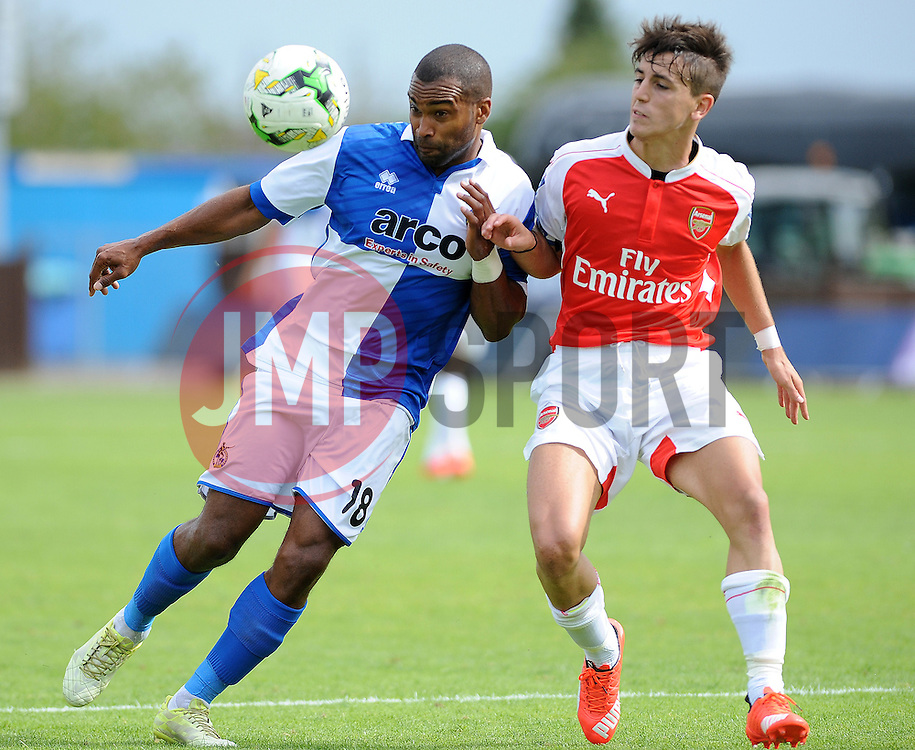Jermaine Easter of Bristol Rovers is challenged by Arsenal's Julio Pleguezuelo - Photo mandatory by-line: Neil Brookman/JMP - Mobile: 07966 386802 - 18/07/2015 - SPORT - Football - Bristol - Memorial Stadium - Pre-Season Friendly