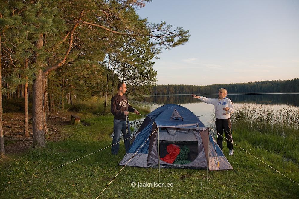 Young Family Assembling Dome Tent, Mennikunno Landscape Reserve,  Põlva County, Estonia