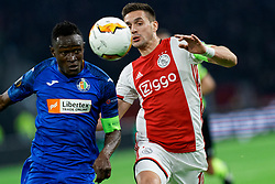 Dusan Tadic #10 of Ajax and Dakonam Djene #2 of Getafe in action during the Europa League match R32 second leg between Ajax and Getafe at Johan Cruyff Arena on February 27, 2020 in Amsterdam, Netherlands