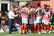 Gary Johnson talks to his players during the EFL Sky Bet League 2 match between Cheltenham Town and Crawley Town at LCI Rail Stadium, Cheltenham, England on 4 August 2018. Picture by Antony Thompson.