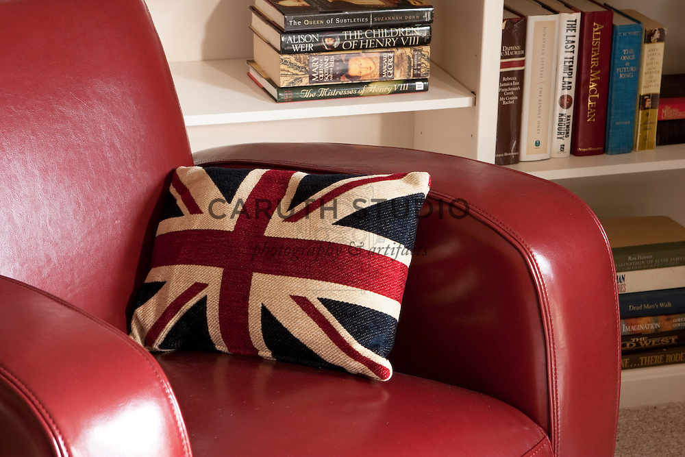 Library corner in living room, leather club chair with Union Jack pillow
