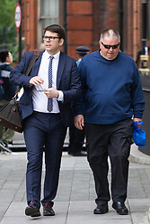 Brian Phillips, right, arrives at Westminster Magistrates Court in London where he is on trial for harassment of MP Anna Soubry outside the Houses of Parliament. LONDON, July 19 2019.