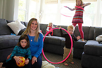 Kelcey Kintner and her family Dylan (girl 7,  striped top) Summer (girl, blue top) Harlowe (pink top 2 y.o.) and Chase (blue top 2y.o.) at their home in Rye NY on April 29, 2012. .Photo Credit ; Rahav Iggy Segev / Photopass.com