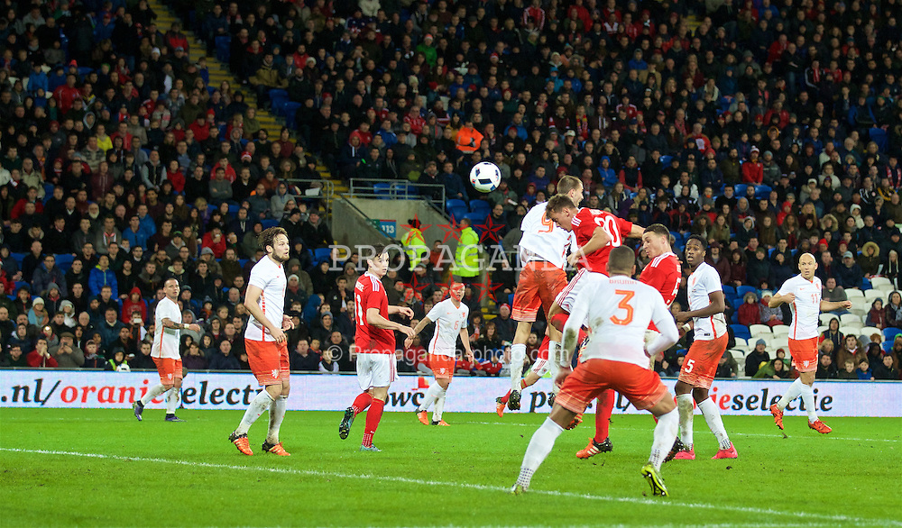 CARDIFF, WALES - Friday, November 13, 2015: Wales' Emyr Huws scores the second equalising goal against the Netherlands during the International Friendly match at the Cardiff City Stadium. (Pic by David Rawcliffe/Propaganda)