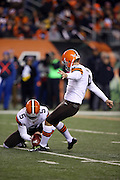 Cleveland Browns punter Spencer Lanning (5) holds while Cleveland Browns kicker Billy Cundiff (8) kicks a first quarter extra point good for a 7-0 Browns lead during the NFL week 10 regular season football game against the Cincinnati Bengals on Thursday, Nov. 6, 2014 in Cincinnati. The Browns won the game 24-3. ©Paul Anthony Spinelli