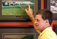 Tom Dittmer points to a photo in the Grandview Farms office as he talks about the farm's history in Eldridge, Iowa on Thursday August 9, 2012.