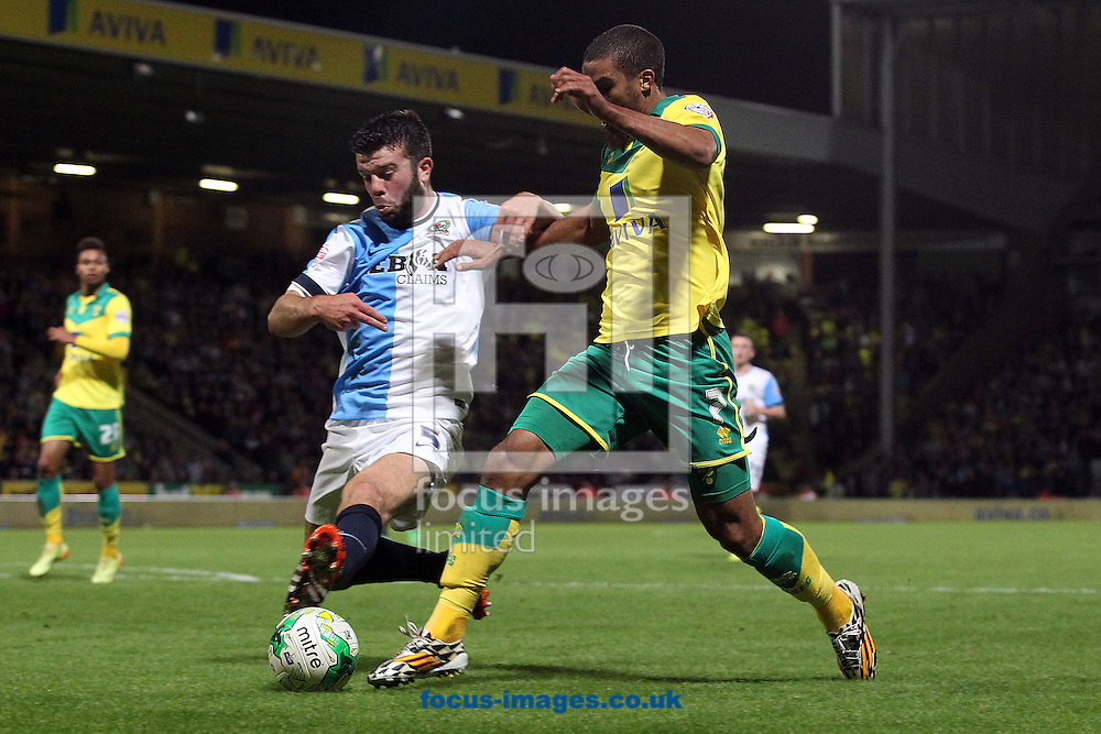 Grant Hanley of Blackburn Rovers and Lewis Grabban of Norwich in action during the Sky Bet Championship match at Carrow Road, Norwich<br /> Picture by Paul Chesterton/Focus Images Ltd +44 7904 640267<br /> 19/08/2014