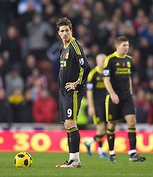 STOKE, ENGLAND - Saturday, November 13, 2010: Liverpool's Fernando Torres looks dejected after his side concede Stoke City's opening goal during the Premiership match against Stoke City at the Britannia Stadium. (Photo by David Rawcliffe/Propaganda)