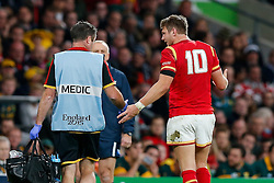 Wales Fly-Half Dan Biggar looks frustrated as he is escorted off for a head injury assessment - Mandatory byline: Rogan Thomson/JMP - 07966 386802 - 17/10/2015 - RUGBY UNION - Twickenham Stadium - London, England - South Africa v Wales - Rugby World Cup 2015 Quarter Finals.