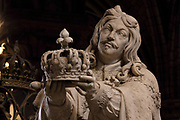 Louis XIII holding a crown, c. 1708, by Guillaume Coustou the Elder, 1677-1746, to the right of the Pieta, 1712-28, marble, by Nicolas Coustou, 1658-1733, behind the altar in the Cathedrale Notre-Dame de Paris, or Notre-Dame cathedral, built 1163-1345 in French Gothic style, on the Ile de la Cite in the 4th arrondissement of Paris, France. Photographed on 17th December 2018 by Manuel Cohen
