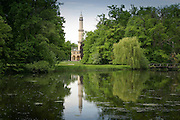 A reflection of the Minaret - part of the Lednice Castle - and the castle park with grazing sheep resemble a scene from old paintings. Southern Moravia region - Czech Repuclic.