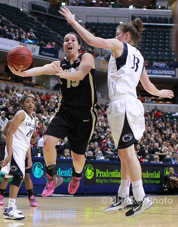 March 03, 2012; Indianapolis, IN, USA; Purdue Boilermakers guard Courtney Moses (15) shoots the ball against Penn State Lady Lions guard Maggie Lucas (33) during the semifinals of the 2012 Big Ten Tournament at Bankers Life Fieldhouse. Mandatory credit: Michael Hickey-US PRESSWIRE