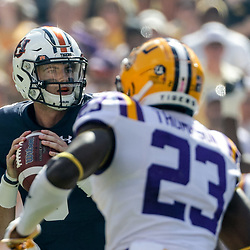 Oct 14, 2017; Baton Rouge, LA, USA; Auburn Tigers quarterback Jarrett Stidham (8) is pressured by LSU Tigers linebacker Corey Thompson (23) during the first quarter of a game at Tiger Stadium. Mandatory Credit: Derick E. Hingle-USA TODAY Sports