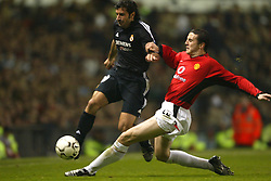 MANCHESTER, ENGLAND - Wednesday, April 23, 2003: Real Madrid's Luis Figo is tackled by Manchester United's John O'Shea during the UEFA Champions League Quarter Final 2nd Leg match at Old Trafford. (Pic by David Rawcliffe/Propaganda)