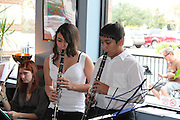 Grady Middle School Band students Alexia Hernandez and Alan Romero perform as part of Ms. Plunkett's Holiday Studio Concert at Bean's Cafe. All of the students played to a full house under the direction of Mr. Leif Hall.<br /> To submit photos for inclusion in eNews, send them to hisdphotos@yahoo.com.