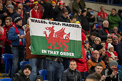 """CARDIFF, WALES - Tuesday, November 19, 2019: A Wales supporter's flag """"Wales. Golf. Madrid"""" during the final UEFA Euro 2020 Qualifying Group E match between Wales and Hungary at the Cardiff City Stadium. Wales won 2-0 and qualified for the Finals. (Pic by David Rawcliffe/Propaganda)"""