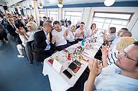 05 JUN 2018, BERLIN/GERMANY:<br /> Johannes Kahrs (Mi-L), MdB, SPD, Sprecher des Seeheimer Kreises, und Lars Klingbeil (Mi-R), SPD Generalsekretaer, und anere Teilnehmer, applaudieren waehrend der Rede von Andera Nahles,<br /> Spargelfahrt des Seeheimer Kreises der SPD, Wannsee<br /> IMAGE: 20180605-01-117