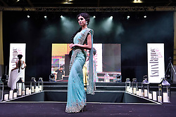© Licensed to London News Pictures. 27/03/2016. Models on a catwalk stage wearing a bridal dress at the Asian Bride Live Wedding Show featuring fashion, beauty and services for brides to be. London, UK. Photo credit: Ray Tang/LNP