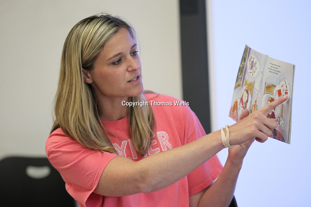 "Joyner Elementary School teacher Cathryn Richey reads the book ""The night before kindergarten"" to students as attend Wednesday's ""Spalsh"" day at Joyner for children who will be attending the school for the first time this fall."