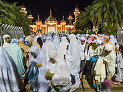18 JUNE 2015 - PATTANI, PATTANI, THAILAND: Women leave the plaza in front of Pattani Central Mosque after Ramadan services. Thousands of people come to Pattani Central Mosque in Pattani, Thailand, to mark the first night of Ramadan. Ramadan is the ninth month of the Islamic calendar, and is observed by Muslims worldwide as a month of fasting to commemorate the first revelation of the Quran to Muhammad according to Islamic belief. This annual observance is regarded as one of the Five Pillars of Islam. Islam is the second largest religion in Thailand. Pattani, along with Narathiwat and Yala provinces, all on the Malaysian border, have a Muslim majority.     PHOTO BY JACK KURTZ