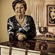 PORTRAITS OF SURVIVORS AND IMMIGRANTS <br /> Sobreviviente del Holocausto / Holocaust Survivor.<br /> <br /> Sra. Rosika Davidsohn de Schachter.<br /> <br /> Nació en Dorabani, Rumania, el 22 de julio de 1922. Teniendo cinco años la familia se mudó a Czernowitz, Ante la inminente guerra se casó en 1940 con Nathan Schachter y en 1941 fueron llevados al gueto de Czernowitz y de inmediato deportados a Mogilev, donde estuvieron hasta 1943. Consiguieron escapar a Dorohoi pero los capturaron de nuevo y los enviaron al gueto de Viznitz. En diciembre de 1944 huyeron a Bucarest, donde nació su hija. En 1950 viajaron a Israel, luego a Curazao donde su esposo fue líder espiritual de la comunidad Ashkenazí, y en 1960 se instaló en Venezuela donde consolidó una familia en la que ha tenido la bendición de ver nacer bisnietos.<br /> <br /> Photography by Aaron Sosa<br /> Caracas - Venezuela 2010<br /> (Copyright © Aaron Sosa)
