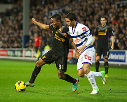 30.12.2012, Loftus Road, London, ENG, Premier League, Queens Park Rangers vs FC Liverpool, 20. Runde, im Bild Liverpool's Raheem Sterling in action against Queens Park Rangers' Fabio Da Silva during the English Premier League 20th round match between Queens Park Rangers and Liverpool FC at Loftus Road, London, Great Britain on 2012/12/30. EXPA Pictures © 2012, PhotoCredit: EXPA/ Propagandaphoto/ David Rawcliffe..***** ATTENTION - OUT OF ENG, GBR, UK *****
