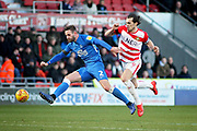 Peterborough Utd defender Jason Naismith (2) and Doncaster Rovers forward John Marquis during the EFL Sky Bet League 1 match between Doncaster Rovers and Peterborough United at the Keepmoat Stadium, Doncaster, England on 9 February 2019.