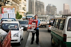 A supporter canvasses for candidate Mohamed Morsi in downtown Cairo. There are 13 candidates in the race..