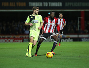 Huddersfield Town defender Martin Cranie taking on Brentford midfielder Toumani Diagouraga during the Sky Bet Championship match between Brentford and Huddersfield Town at Griffin Park, London, England on 19 December 2015. Photo by Matthew Redman.