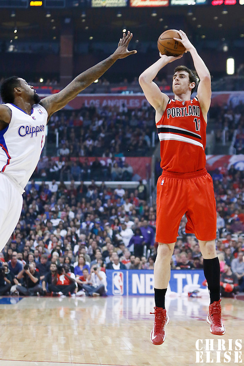 16 April 2013: Portland Trail Blazers small forward Victor Claver (18) takes a jumpshot over Los Angeles Clippers center DeAndre Jordan (6) during the Los Angeles Clippers 93-77 victory over the Portland Trail Blazers at the Staples Center, Los Angeles, California, USA.