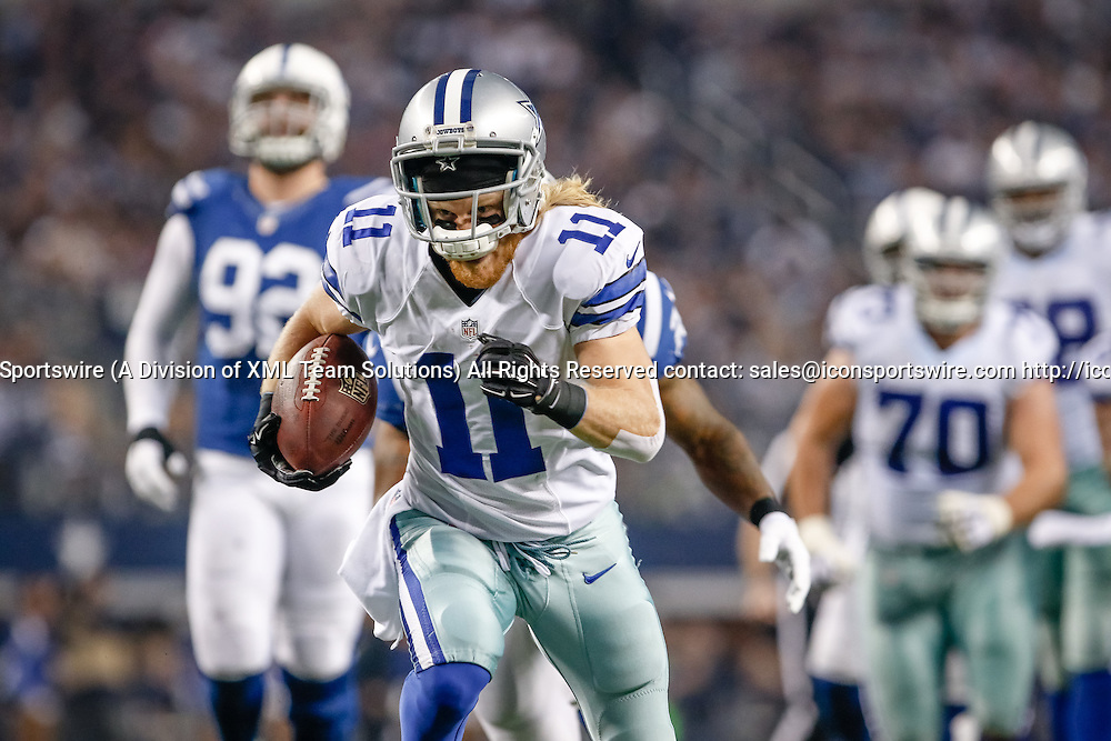 21 DEC 2014: Dallas Cowboys Wide Receiver Cole Beasley (11) [18238] breaks a tackle and scores a touchdown during the NFL game between the Dallas Cowboys and the Indianapolis Colts at AT&T Stadium in Arlington, TX.