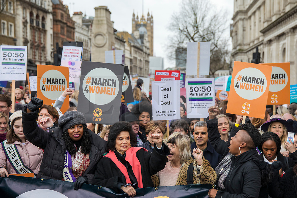 © Licensed to London News Pictures. 04/03/2018. London, UK. Bianca Jagger (centre) raises her fist as she leads March 4 Women through central London, ahead of International Women's Day, to mark the centenary of the Representation of the People's Act 1918 by retracing the steps of the Suffragettes from Parliament to Trafalgar Square. Photo credit: Rob Pinney/LNP