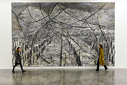 "© Licensed to London News Pictures. 14/11/2019. LONDON, UK. Staff members next to ""The Veneziana Amplitude"", 2019, by Anselm Kiefer at the preview of a new exhibition called ""Superstrings, Runes, The Norns, Gordian Knot"" by Anselm Kiefer.  The works include large scale paintings and installations that draw on the scientific concept of string theory and are on display at the White Cube Gallery in Bermondsey 15 November to 26 January 2020.  Photo credit: Stephen Chung/LNP"