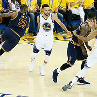 01 June 2017: Cleveland Cavaliers forward LeBron James (23) drives past Golden State Warriors guard Shaun Livingston (34) and Golden State Warriors guard Stephen Curry (30)  during the Golden State Warriors 113-90 victory over the Cleveland Cavaliers, in game 1 of the 2017 NBA Finals, at the Oracle Arena, Oakland, California, USA.