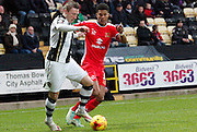 Garry Thompson and Jordan Spence during the Sky Bet League 1 match between Notts County and Milton Keynes Dons at Meadow Lane, Nottingham, England on 26 December 2014. Photo by Jodie Minter.