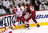 Apr 23, 2010; Glendale, AZ, USA; Detroit Red Wings defenseman Brad Stuart (23) and Phoenix Coyotes center Daniel Winnik (34) battle for a loose puck during the first period of game five in the first round of the 2010 Stanley Cup Playoffs at Jobing.com Arena.  Mandatory Credit: Jennifer Stewart-US PRESSWIRE