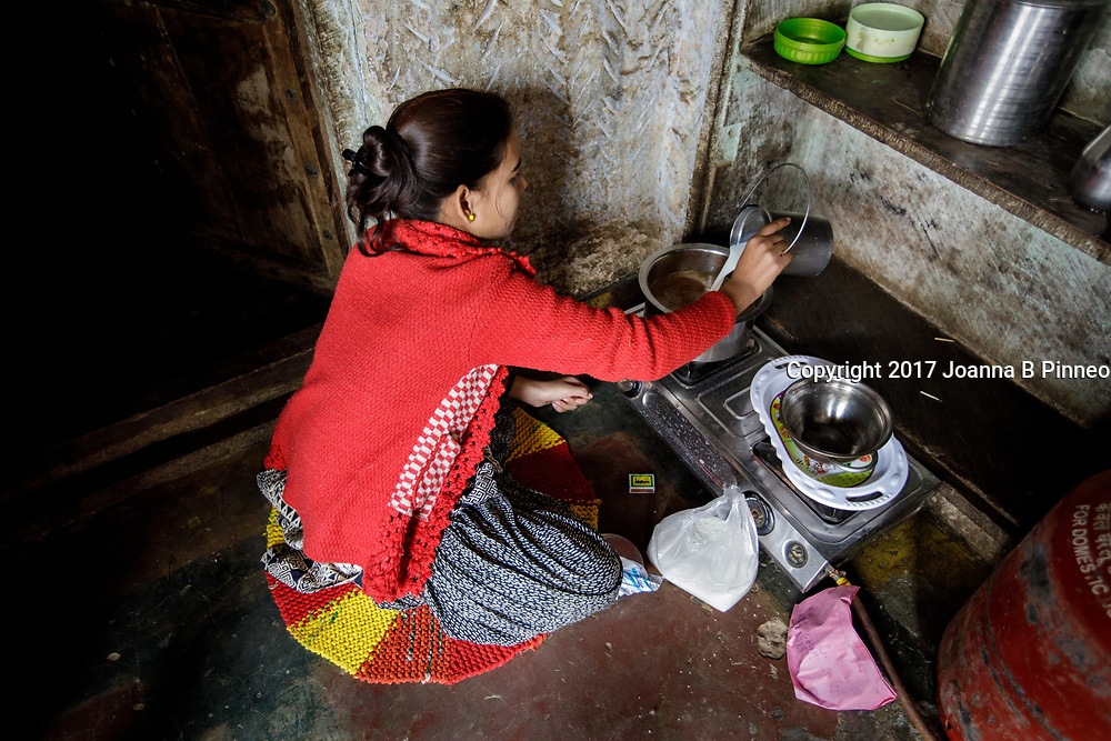 Making tea on the LPG stove. India.