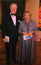 SIR JOCELYN STEVENS and MRS VIVIEN DUFFIELD, at a dinner in London on 27th May 1998.MHX 81